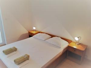 11-apartments-vrtlici-a3-sleeping-room4b816ef0-f337-eabe-312e-f9c84001a520