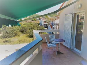 18-apartments-vrtlici-a4-terrace-north-side132bb276-d410-91fa-f6e3-1945b7ab980e