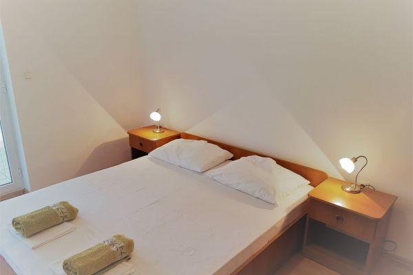 11-apartments-vrtlici-a3-sleeping-room4b816ef0-f337-eabe-312e-f9c84001a520CFE26B2A-C44F-1B28-BF70-3889014D42AD.jpg